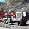 QJ341 Mobile jaw crusher and QH331 Mobile cone crusher working in limestone